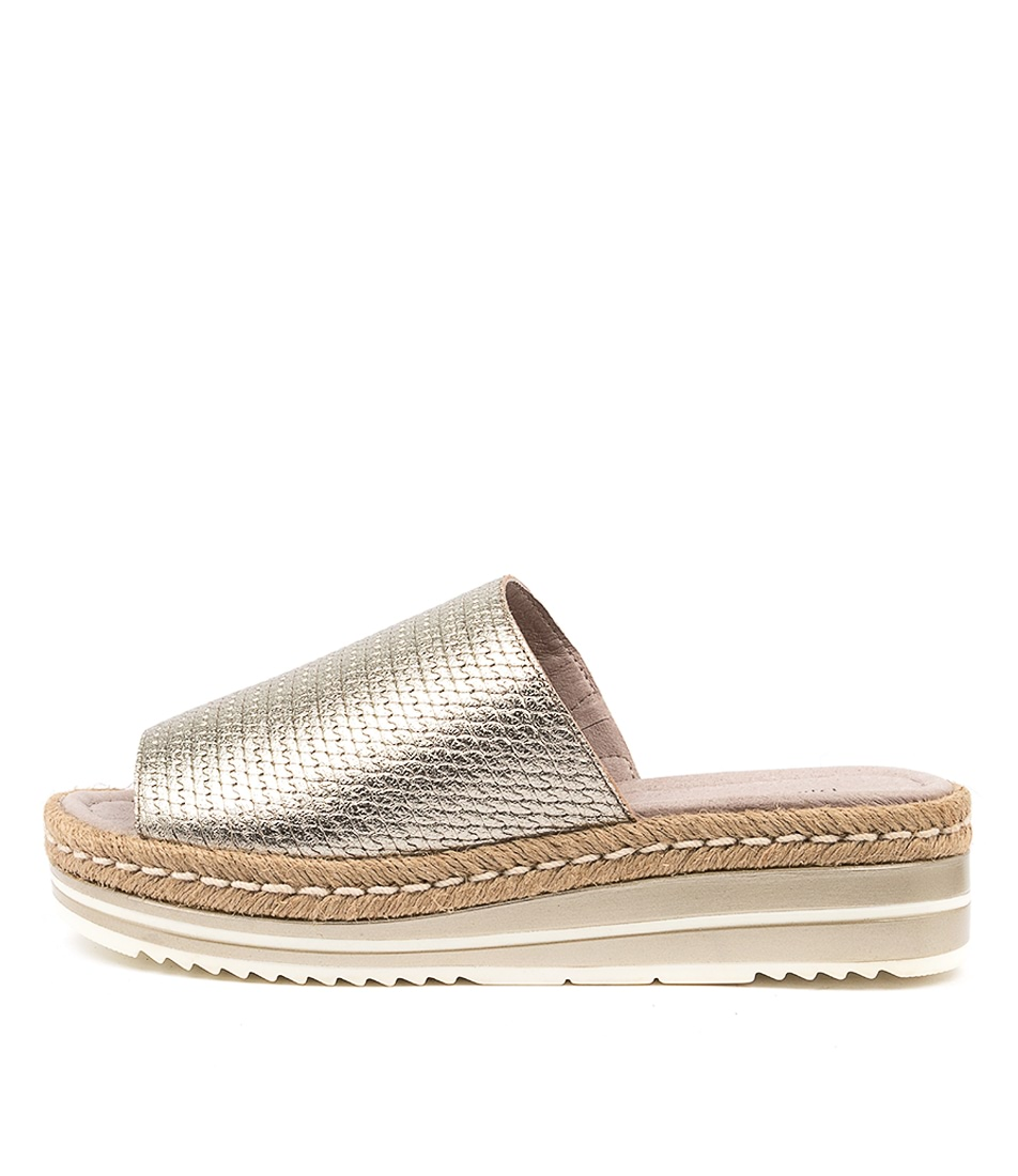 Buy Django & Juliette Accent Champagne Flat Sandals online with free shipping