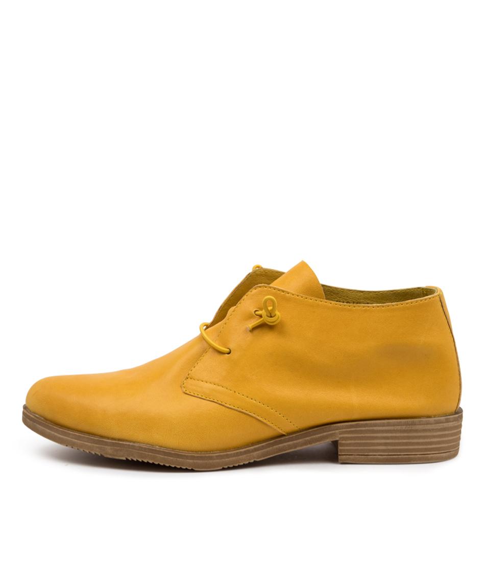 Buy Django & Juliette Karaf Dk Yellow Tan Flats online with free shipping