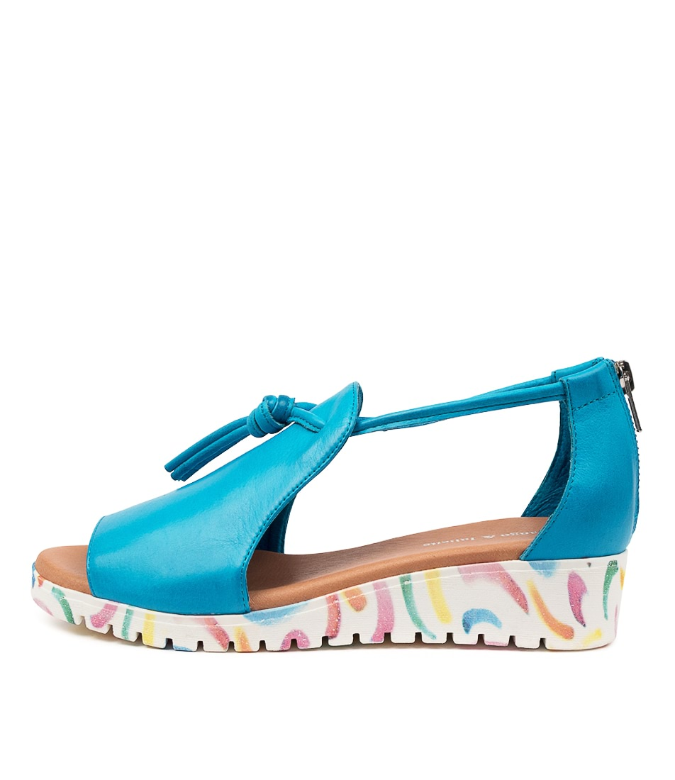 Buy Django & Juliette Melvin Turquoise Curl Sole Flat Sandals online with free shipping