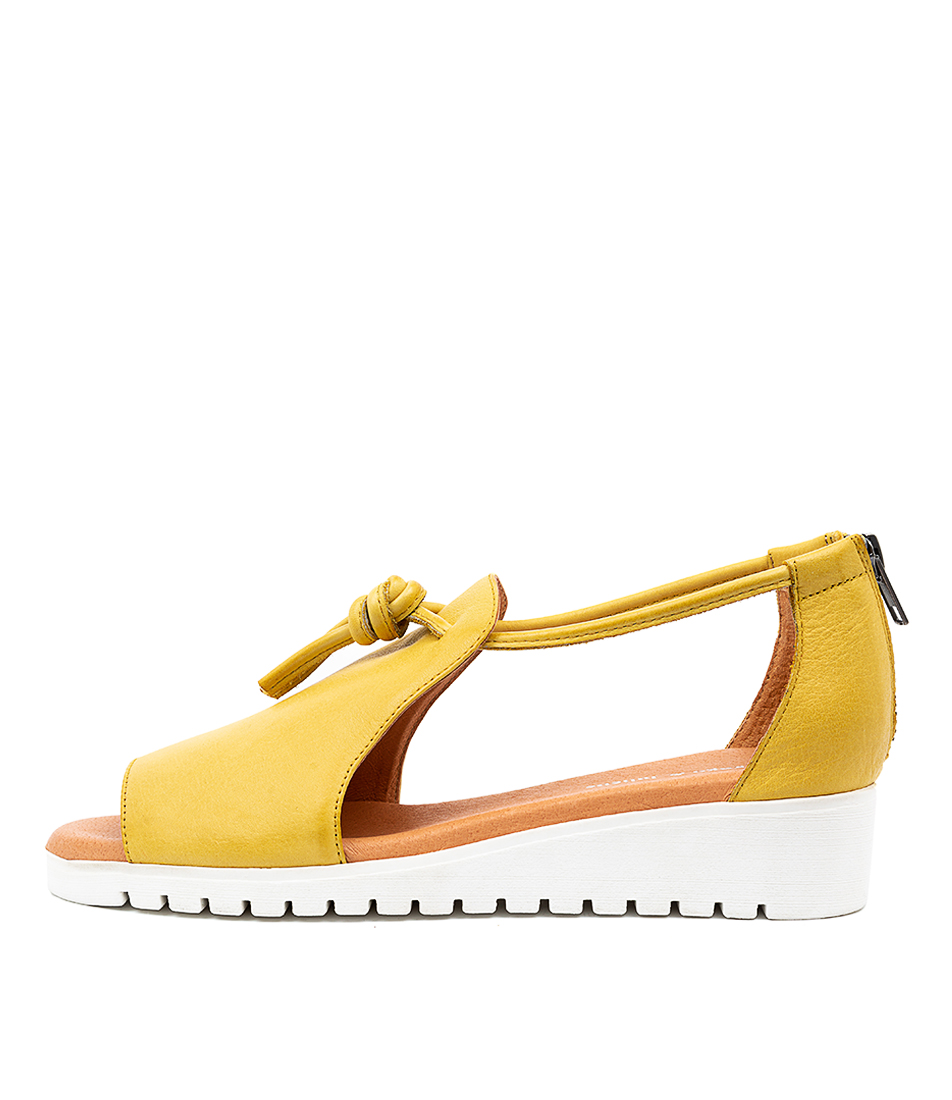 Buy Django & Juliette Melvin Lt Yellow White Sole Flat Sandals online with free shipping